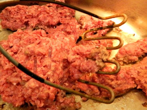 A potato masher makes short work of breaking down ground meats.