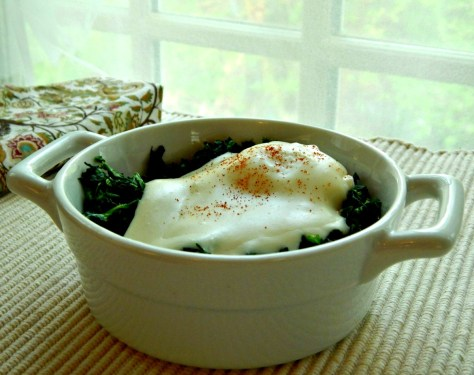 Eggs Florentine - poached eggs blanketed by a cheesy sauce on top a bed of flavorful spinach