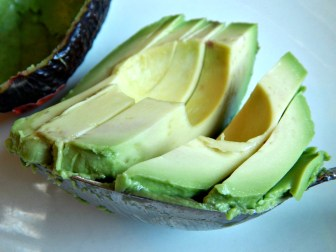 Use an appropriate sized spoon to scoop out the avocado