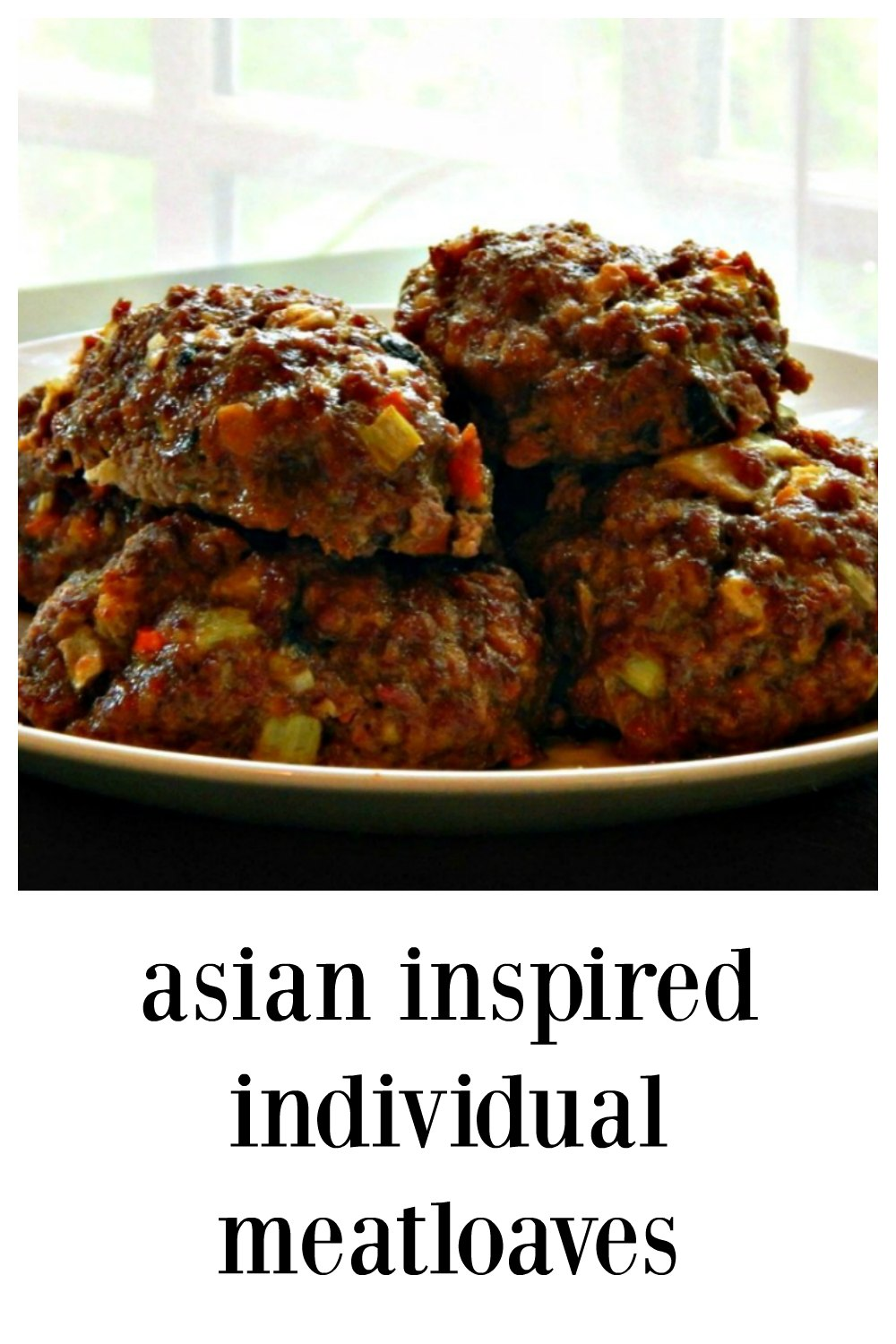 Baby Asian Inspired Individual Meatloaves area crazy cultural mix-up. The gorgeous, crusty exterior gives way to a tender meatloaf with a teriyaki kick. They cook up fast! An under 30 meatloaf! #Meatlof #AsianMeatloaf #IndividualAsainMeatloaf