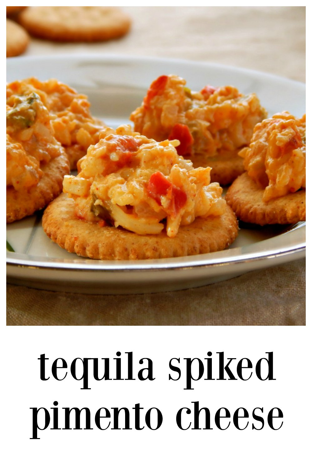 White Cheddar, a touch of tequila, lots of red pepper flavor and a little jalapeno goes into this Tequila Spiked Pimento Cheese! Fabulous warm or cold! Try on crackers, broiled on crostini or over French fries! #TequilaPimentoCheese #PimentoCheese #GameDayAppetizers
