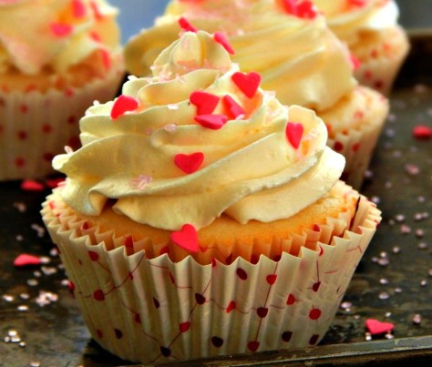 Raspberry filled Vanilla Cupcakes with White Chocolate Buttercream Frosting.