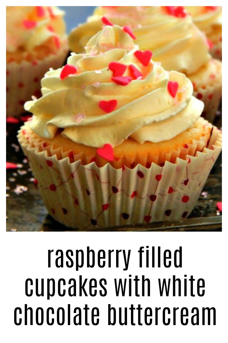 Raspberry Filled Cupcakes with White Chocolate Buttercream; the filled cupcakes are amazing, but then pile on that white chocolate buttercream! Heaven! #RaspberryFilledCupcakes #WhiteChocolateButtercream #RaspberryFilledCupcakesWhiteChocolateButtercream