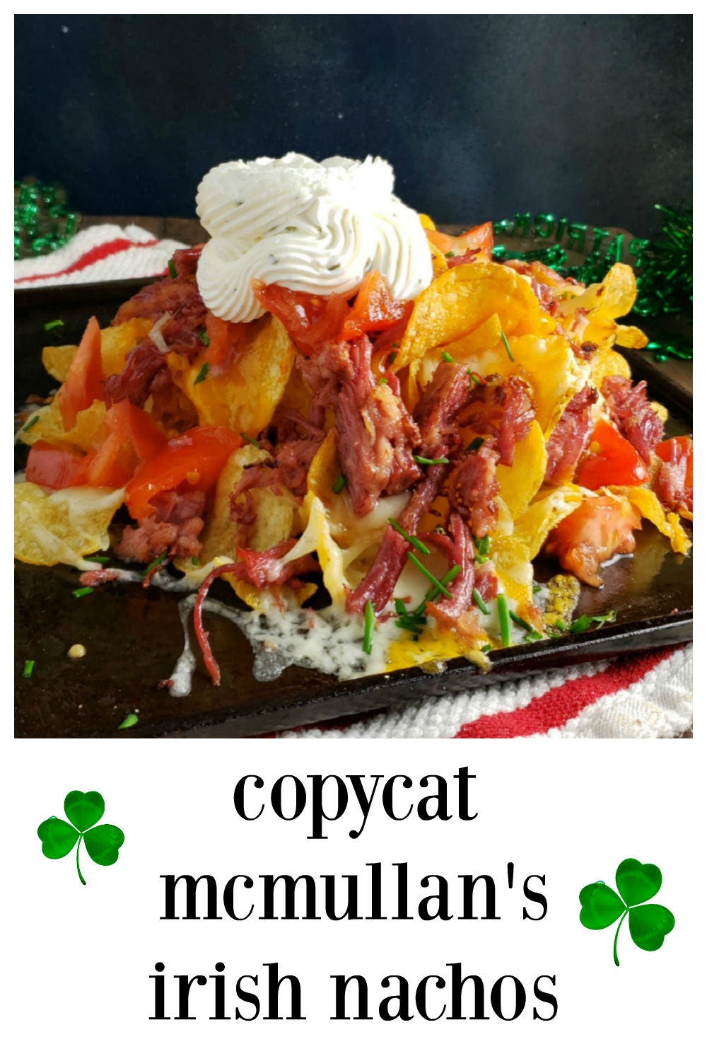 McMullan's Irish Nachos. These are crispy, crunchy homemade potato chips (or use kettle chips) loaded with cheese, crisped corned beef (or taco meat, chicken, carnitas, bacon) Sour Cream, tomatoes, chives. Add pickled jalapenos and lime if ya want! They're insane! #Nachos #IrishNachos #McMullansIrishNachos #PotatoNachos #CornedBeefNachos #MegaDopeChos #CornedBeef #LeftoverCornedBeef #StPaddysDayRecipes #IrishFood