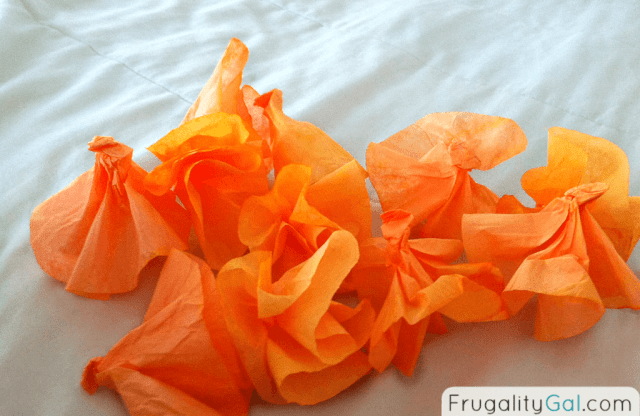 Tutorial on making a dyed coffee filter wreath. Easy and inexpensive project that gives a lot of bang for your buck! Via www.frugalitygal.com