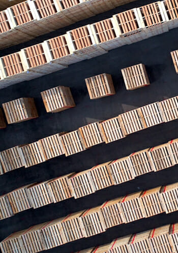 Aerial View of Many Pallets Stacked in a Lot In Rows