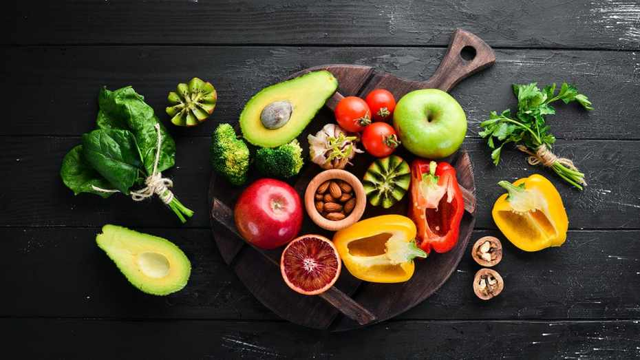 A Variety of Healthy Fruits and Foods Including Kiwi, Apple, Avocado, Pepper, Grapefruit, Almonds and Spinach