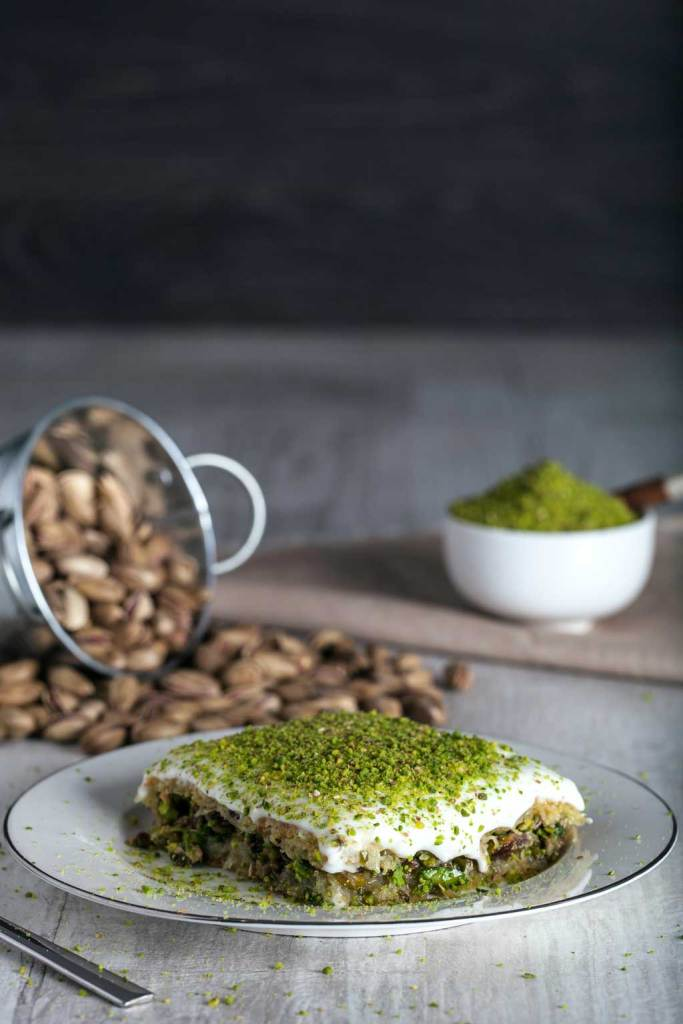 A kadayif desert with grated pistachios