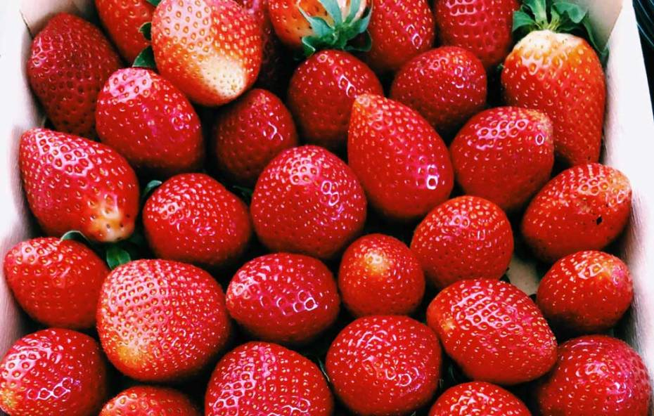 A box of perfectly ripe strawberries.