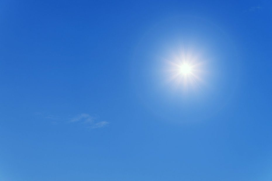 The sun in a clear blue sky in the daytime