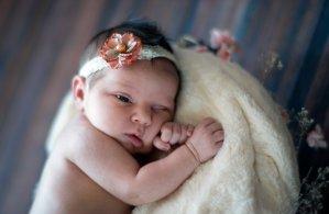 awake newborn portrait with vintage gold flower lace headband
