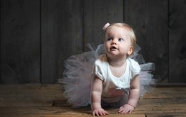 one year old portraits baby girl crawling in tutu