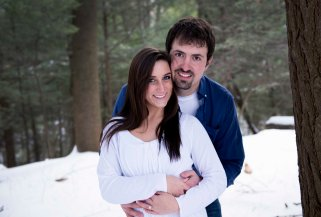 winter engagement portraits snow and pine trees