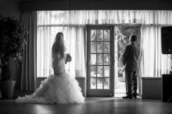 bride and her father waiting to walk down the aisle