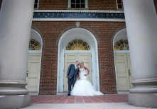 bride and groom kiss in front of Waller Hall on IUP campus