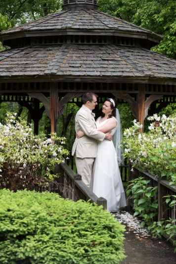 bride and groom portraits in gazebo at Camp Kon O Kwee grounds