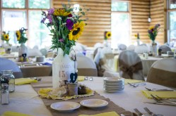 sunflowers and wild flowers in milk jugs as wedding center pieces