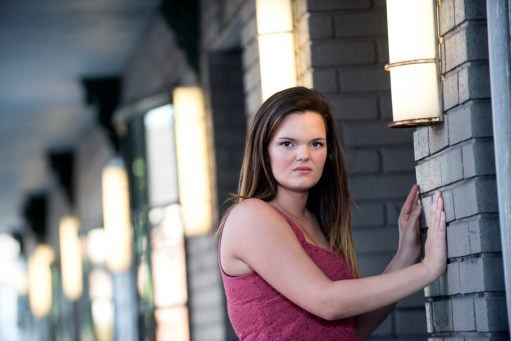 Katrina senior portraits outside of apartment building in Indiana PA