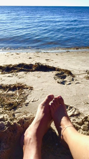 Enjoying the sun on the beach in Denmark
