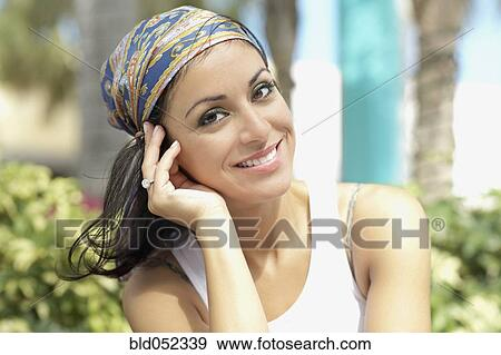 hispanic woman wearing scarf