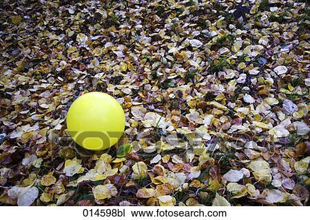 stock of yellow balloon lying