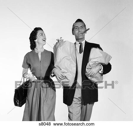 Pictures of 1950S Couple Walking Woman Smiling At Man
