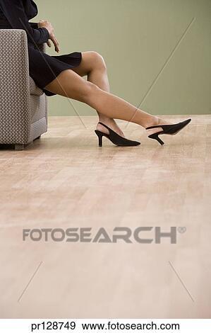 Bare legs of businesswoman wearing short skirt Stock Photo   pr128749   Fotosearch