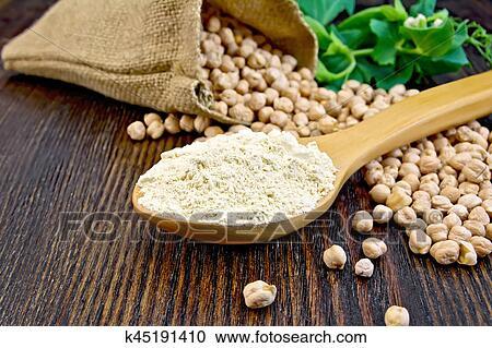 Flour chickpeas in spoon on board Stock Image   k45191410   Fotosearch