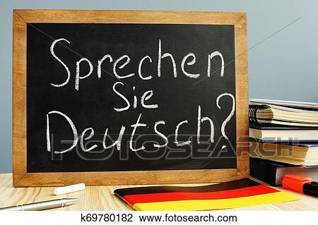 Sprechen Sie Deutsch written on a blackboard. Learn German concept. Stock Image | k69780182 | Fotosearch