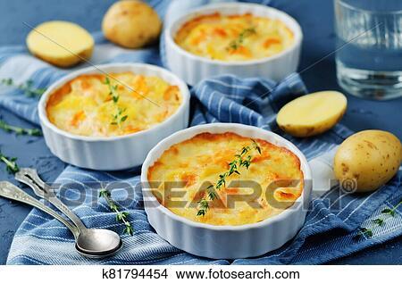 Kürbis. kartoffel. gratin Bild | k81794454 | Fotosearch