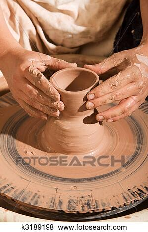 Picture - Potter Shaping Clay. Fotosearch - Search Stock Photos, Images, Print Photographs, and Photo Clip Art