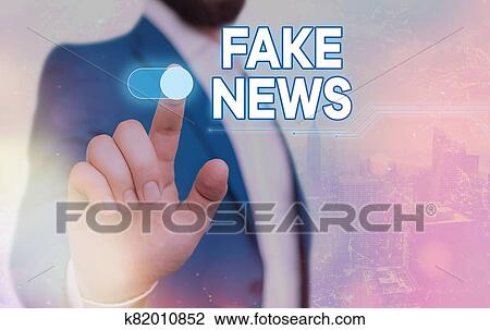 Handwriting text Fake News. Concept meaning false content published without no credibility to deceive readers. Stock Image   k82010852   Fotosearch