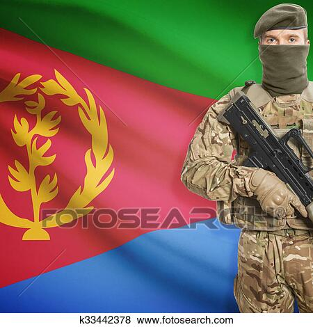 Picture - Soldier holding machine gun with flag on background series - Eritrea. Fotosearch - Search Stock Photos, Images, Print Photographs, and Photo Clip Art