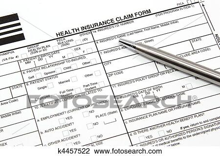 Stock Photo of Health Insurance Claim Form with Silver Pen