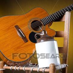 Rope Bottom Chair Bean Bag Stool Stock Photo Of Guitar Old Pottery Jug On K4988654 Search An Potter Ceramic Country With A And Gold Background In The Vertical Format Copy Space