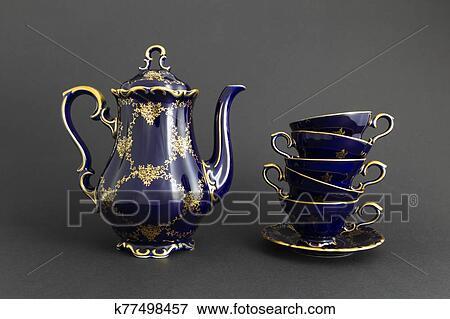 Beautiful cobalt blue colored vintage porcelain tea set with gold ornament Stock Photo   k77498457   Fotosearch