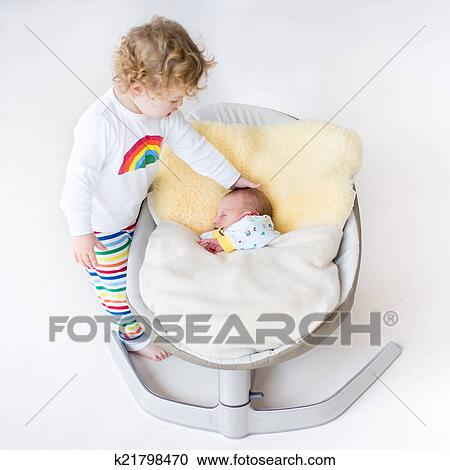 baby sleeping chair hanging double stock photography of tiny newborn in a swing on sheepskin with his to