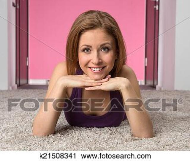 Smiling Teen Girl In Purple T Shirt Face Closeup Of Sexy Girl Lying On Floor And Relaxing