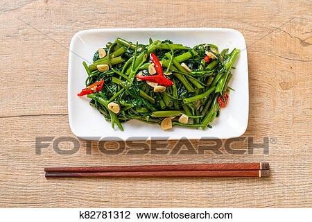 Stir-Fried Chinese Morning Glory or Water Spinach Stock Image | k82781312 | Fotosearch