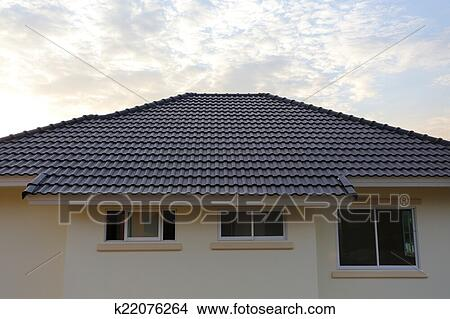 black tiles roof on a new house with