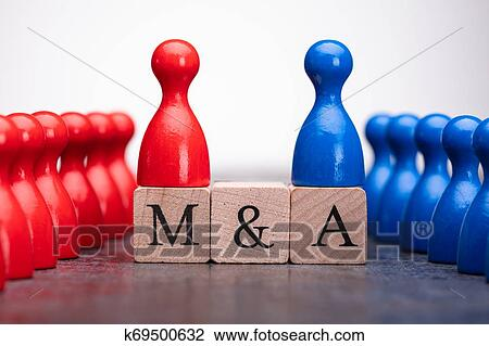 Pieces On Wooden Blocks With Mergers And Acquisitions Text Stock Image   k69500632   Fotosearch