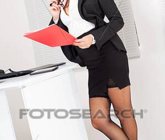 Sexy Business Woman Standing In The Office And Reading Document
