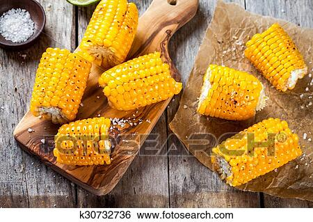 Grilled sweet corn with salt Stock Photograph | k30732736 | Fotosearch
