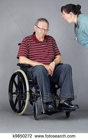 wheelchair man swing chair singapore stock photo of sad senior in being shouted at by elder abuse concept with head down a as crazy nurse or other health care worker is yelling him