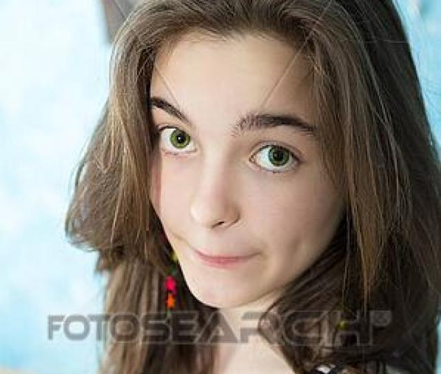 Picture Beautiful Teenage Girl Looking Caught Into The Camera Fotosearch Search Stock Photos