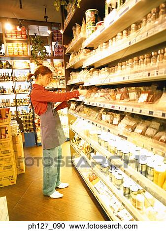 female store attendant arranging