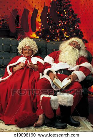 Stock Photography of portrait of Santa and Mrs Claus relaxing on the couch x19096190  Search