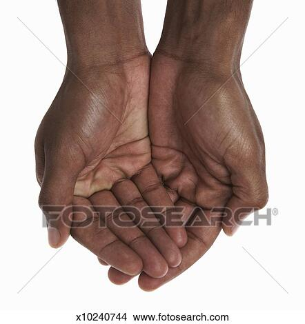 young man cupping hands