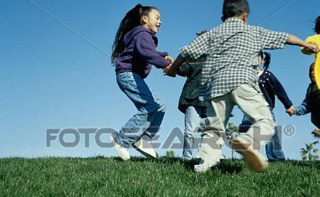 Stock Images Of Children Playing Ring Around The Rosy