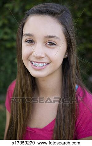 Portrait of 12 year old girl with braces Stock Image   x17359270   Fotosearch